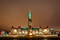 I was wandering around downtown Ottawa waiting to photograph the lunar eclipse. It was a very cloudy night and it gradually became more and more obvious that the eclipse was not in the cards for me. On the way out of town I stopped by Parliament Hill to create a few images of the Hill with all the Christmas Lights in full display. It's a beautiful scene and obviously very photogenic!!..©2010, Sean Phillips.http://www.RiverwoodPhotography.com
