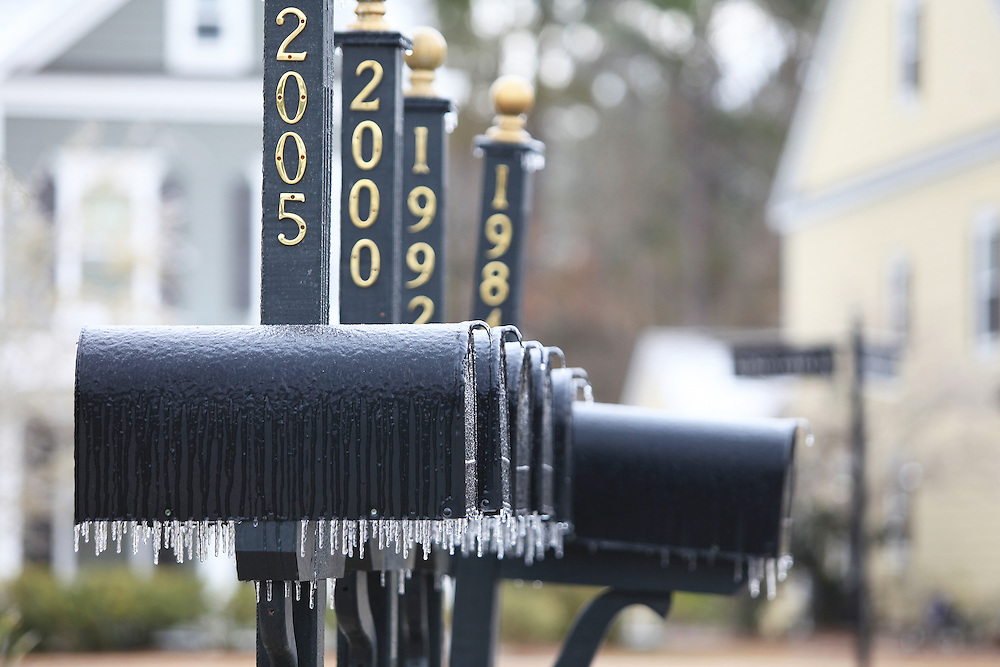 Mailboxes are covered with ice in the Dunes West neighborhood of Mount Pleasant after a long period of freezing rain ended Wednesday, Jan. 29, 2014. (ANDREW KNAPP/STAFF)