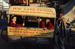 Children travelling to private school in painted cart; Delhi; India,