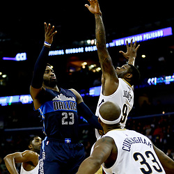Dec 26, 2016; New Orleans, LA, USA;  Dallas Mavericks guard Wesley Matthews (23) passes as New Orleans Pelicans forward Terrence Jones (9) defends during the second quarter of a game at the Smoothie King Center. Mandatory Credit: Derick E. Hingle-USA TODAY Sports