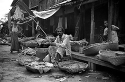 BANGLADESH DHAKA FEB95 - A trader offers his wares, Betelnuts and paan leaves, spread out in baskets in front of him at the Mohammadpur Bihari camp in Dhaka, Bangladesh...jre/Photo by Jiri Rezac..© Jiri Rezac 1995