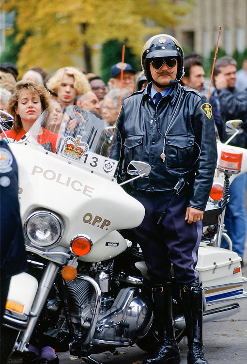 Motorcycle policeman on crowd control in Canada