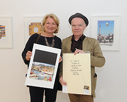Nicky Dowd getting a signed print from artist Sean Hillen at the exhibition of Sean&rsquo;s work at the Custom House Studios which is part of this year&rsquo;s Westport Art&rsquo;s festival. <br /> Pic Conor McKeown