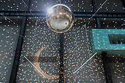 The disco ball for the audience participation elements. Charmatz's Musée de la danse (dancing museum) perform at the Tate Modern - the dress rehearsal of a dance performance in the Turbine Hall, choreographed by French dancer and choreographer Boris Charmatz - 14 May 2015.  A team of 90 dancers will stage free performances throughout the building between 12.00 and 22.00 on Friday 15 and Saturday 16 May. Visitors will also be invited to participate in a warm up, a workshop and an open dancefloor.  As part of Musée de la danse in London, Boris Charmatz will also be staging two works and performing at Sadler's Wells from 17 to 23 May.