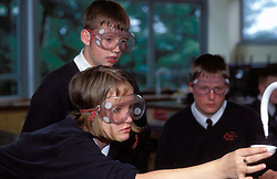 Chemistry class at secondary school; UK, Pupils doing an experiment