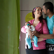 Giusy and Vinod - Gordola, Switzerland, October 2015.&nbsp;<br /> Giusy, Vinod together with their son Isaac, 40 days old. Giusy 28, Swiss-Italian origins, discovered that she was affected by multiple sclerosis in 2011. Her partner, Vinod, 32, was born in Switzerland of Indian parents from Kerala. Giusy and Vinod met in 2012 and married in 2014. The devoted support of her partner has been essential for Giusy in this delicate time. For them, the disease it has never been an obstacle to the desire of having a child. Giusy and Vinod wish to other couples in similar situations to have the same strength.<br /> Giusy e Vinod (Gordola, Svizzera, Ottobre 2015. Giusy e Vinod insieme al loro figlio Isaac, 40 giorni. Giusy, 28 anni, ticinese di origini italiane, ha scoperto di essere affetta da sclerosi multipla nel 2011. Il suo compagno, Vinod, 32 anni, &egrave; nato in Svizzera da genitori indiani del Kerala. Giusy e Vinod si sono conosciuti nel 2012 e sposati nel 2014. L'appoggio sereno e premuroso di Vinod &egrave; stato fondamentale per Giusy in questo periodo di cambiamento. La malattia non &egrave; mai stata per loro un freno alla volont&agrave; di avere un figlio. Ad altre coppie in situazioni simili augurano di avere la loro stessa forza.