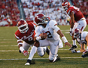 Arkansas linebacker De'Jon Harris has all of Alabama quarterback Jalen Hurts' (2) face mask as he tries to keep Hurts from scoring during the first half of the game in Fayetteville Saturday, October 8, 2016.  Staff Photo/Gary Cosby Jr.