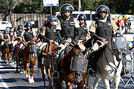 Mounted and armed police move into position at the stadium before the 2014 FIFA World Cup match at Mineirao, Belo Horizonte, Brazil. <br /> Picture by Andrew Tobin/Focus Images Ltd +44 7710 761829<br /> 24/06/2014