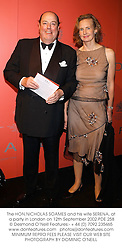 The HON.NICHOLAS SOAMES and his wife SERENA, at a party in London on 12th September 2002.	PDE 258