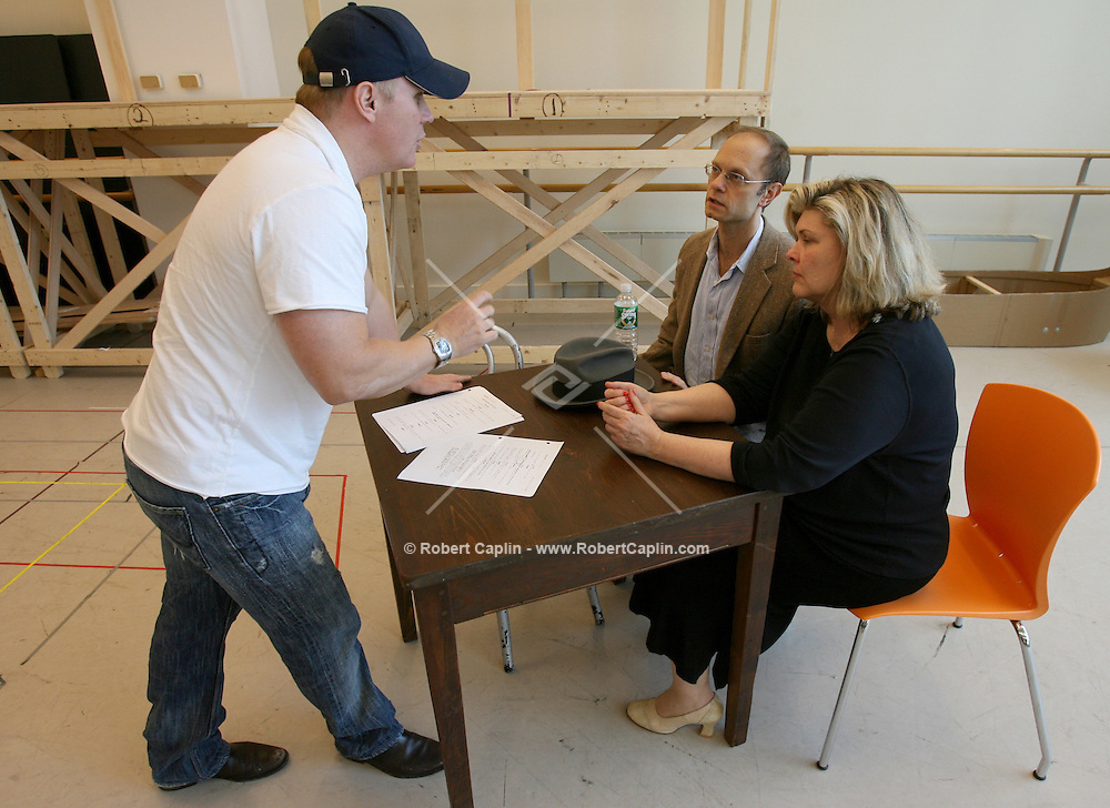 Director Scott Ellis, left, speaks with cast members David Hyde Pierce, center, and Debra Monk during a rehearsal of Curtains, a new musical created by the legendary team of Kander and Ebb at the New 42nd St. Studios in Manhattan. They finished the musical before Ebb s death, making it the last Kander and Ebb musical ever. The production will have its pre-Broadway run at the Ahmanson beginning in August.  7/3/06