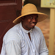Costumed interpreter portrays an early black colonist at Colonial Williamsburg, VA.