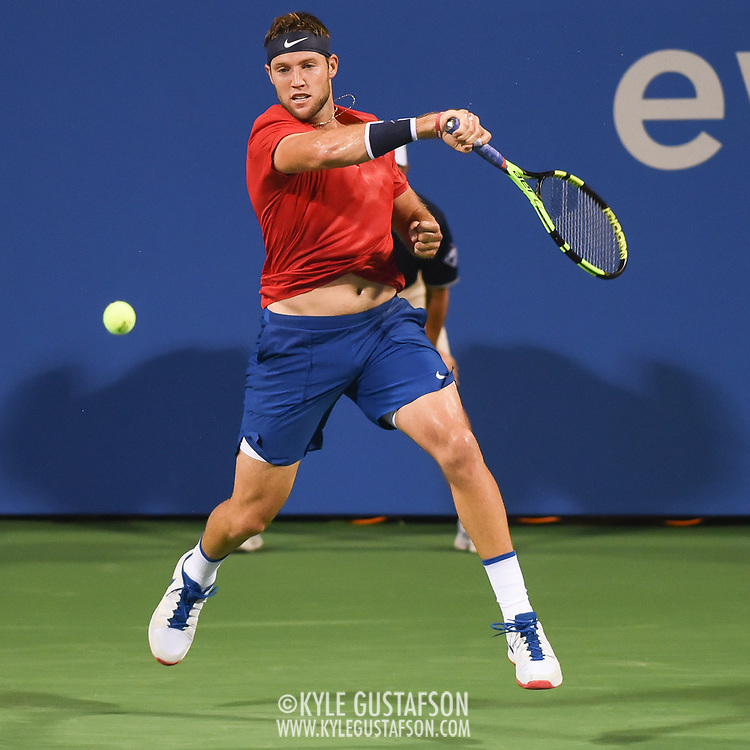 JACK SOCK hits a forehand during his second round match at the Citi Open at the Rock Creek Park Tennis Center in Washington, D.C.