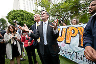 Occupy LA in Los Angeles. Hundreds of protesters are sleeping on the lawn of LA City Hall to protest corporate greed. L.A. City Councilman Eric Garcetti, 13th council district, speaks to a crowd of Occupy LA protesters on the lawn of LA City Hall.