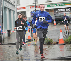 Gary Cunningham Westport United Goalkeeper taking it all in his stride at  the Streets of Westport 5K run on New Year's Day.<br /> Pic Conor McKeown