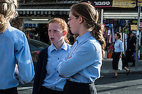 School girls talk after school as they stand along Mea Sharim St, Jerusalem
