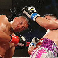KISSIMMEE, FL - MARCH 06:  Charles Natal (R) trades punches with Juan Aguirre during the Telemundo Boxeo boxing match at the Kissimmee Civic Center on March 6, 2015 in Kissimmee, Florida. (Photo by Alex Menendez/Getty Images) *** Local Caption ***  Charles Natal; Juan Aguirre