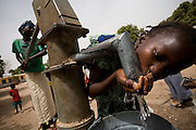 A girl drinks water from a water pump at the Oulampane primary school in the town of Oulampane, Senegal, on Tuesday June 12, 2007.