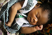 Newborn child in the maternity ward of the Magburaka government hospital in the town of Magburaka, Sierra Leone on Monday March 15, 2010.