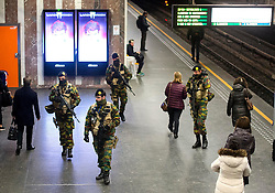© Licensed to London News Pictures. 25/11/2015. Brussels, Belgium. Belgian military on the platform at Louise Metro station in Central Brussels where the Metro transport system is now running and some schools have reopened following closure due to security fears. The Belgian capital has been on lockdown and the highest security alert due to fears of a terrorist attack following the recent attacks in Paris. Photo credit: Ben Cawthra/LNP