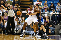 March 9, 2011; Sacramento, CA, USA;  Sacramento Kings center Jason Thompson (34) is defended by Orlando Magic power forward Ryan Anderson (33) during the second quarter at the Power Balance Pavilion.