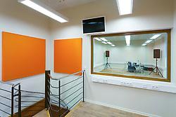 Practice room in H. Eller music school in Tartu, Estonia. Empty classroom with drums and loudspeakers. Boards on wall.