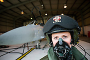 Weapons Systems Officer, Flt Lt Sarah Carmichael with her Tornado F3  in a QRA shed at RAF Mount Pleasant, Falkland Islands, 16th September 2009.