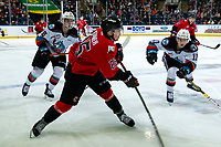 KELOWNA, BC - DECEMBER 30: Liam Kindree #26 and Pavel Novak #11 of the Kelowna Rockets check Mitchell Kohner #25 of the Prince George Cougars as he passes the puck during first period at Prospera Place on December 30, 2019 in Kelowna, Canada. (Photo by Marissa Baecker/Shoot the Breeze)