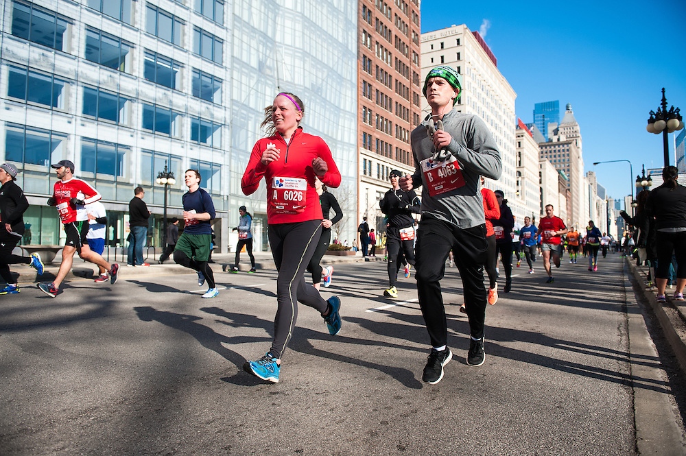 Runners head down Michigan Avenue as they approach the final mile of the Bank of America Shamrock Shuffle 8K, which is the world's largest 8-kilometer road race.