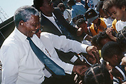 President Nelson Mandela greets children in Manenburg, Cape Town 1994.<br /> <br /> Photograph &copy; nic bothma