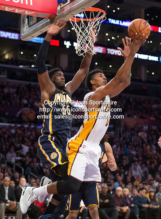 Jan. 4, 2015 - Los Angeles, CA, USA - The Lakers' Nick Young, right, tips a finger roll past the Pacers' Roy Hibbert during a game at Staples Center on Sunday.
