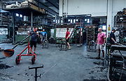 Italy, Resana, Veneto: glass blowers at Nuova Vetreria Resanese, producing for Pulpo designers