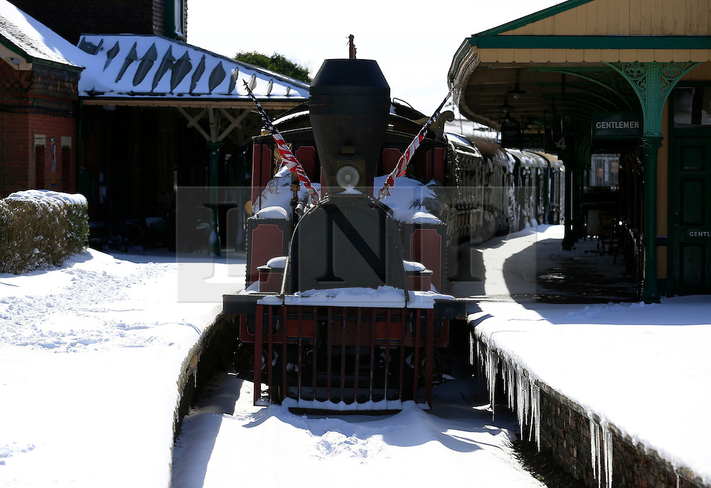© Licensed to London News Pictures. 12/03/2013, Haywards Heath, UK.  A steam train is seen stations at snow covered Bluebell Railways' Horsted Keynes station, near Haywards Heath, West Sussex, England, as cold weather continues to affect much of UK, Tuesday, March 12, 2013. Photo credit : Sang Tan/LNP