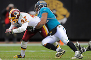Washington Redskins tight end Chris Cooley (47) is tackled by Jacksonville Jaguars linebacker Daryl Smith (52) during the Redskins 20-17 overtime win at EverBank Field on Dec. 26, 2010 in Jacksonville, Fl. ©2010 Scott A. Miller