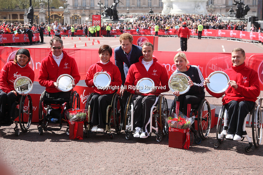22.04.2012 London, England. Prince Harry poses with the winners of the 2012 Virgin London wheelchair Marathon on The Mall, in front of Buckingham Palace.