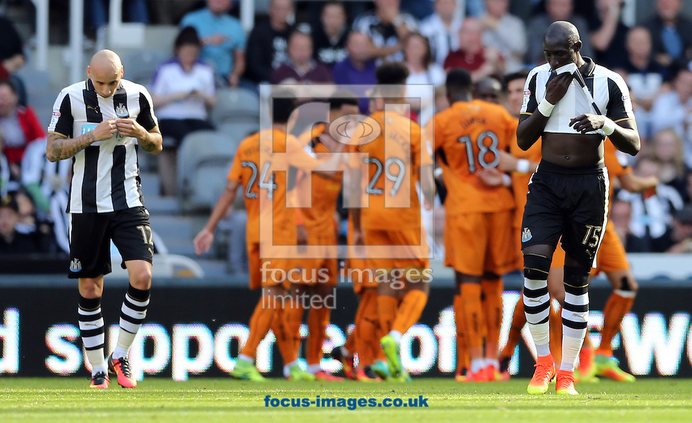 Jonjo Shelvey (l) and Mohamed Diame (r) of Newcastle United react as Wolverhampton Wanderers celebrate scoring the opening goal (background) during the Sky Bet Championship match at St. James's Park, Newcastle<br /> Picture by Simon Moore/Focus Images Ltd 07807 671782<br /> 17/09/2016