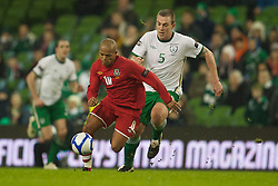 DUBLIN, IRELAND - Tuesday, February 8, 2011: Wales' Robert Earnshaw and the Republic of Ireland's Richard Dunne during the opening Carling Nations Cup match at the Aviva Stadium (Lansdowne Road). (Photo by David Rawcliffe/Propaganda)
