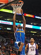 Jan. 30, 2011; Phoenix, AZ, USA; New Orleans Hornets forward Trevor Ariza (1) dunks the ball against the Phoenix Suns during the first half at the US Airways Center. Mandatory Credit: Jennifer Stewart-US PRESSWIRE