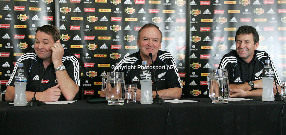 All Black head coach Graham Henry (M) talks at the press conference that named the All Black team to play the Lions on Saturady in Wellington in the second test. With fellow coaches Steve Hanson(L) and Wayne Smith (R) at the NZRUHQ Wellington, New Zealand. 28th June 2005. Photo: Marty Melville/PHOTOSPORT.<br />