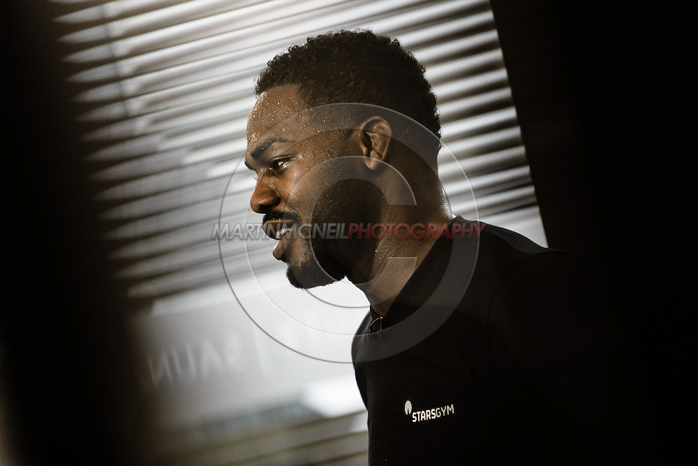 LONDON, ENGLAND, AUGUST 2, 2013: UFC light-heavyweight champion Jon Jones is pictured being intervewed by a television crew inside Stars Gym in Battersea, London, England on Friday, August 2, 2013 © Martin McNeil