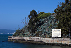 Warning sign on the shore of Alcatraz Island, Golden Gate National Recreation Area, San Francisco, California.