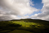 Sunlight shines through clouds near Dingle, Co. Kerry, Ireland. on Thursday, July 5, 2007. (Photo/John Froschauer).