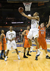 Georgia Tech forward Jeremis Smith (32) finishes a reverse layup after being fouled.  The Virginia Cavaliers faced the Georgia Tech Yellow Jackets in the first round of the 2008 ACC Men's Basketball Tournament at the Charlotte Bobcats Arena in Charlotte, NC on March 13, 2008.