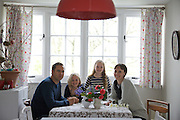 The Elliott family in their dining room. From left to right: Richard Elliott, Milly-grace (8), Molly Elliott (10), Tracey Elliott. Pickwell Manor, Georgeham, North Devon, UK.<br /> CREDIT: Vanessa Berberian for The Wall Street Journal<br /> HOUSESHARE