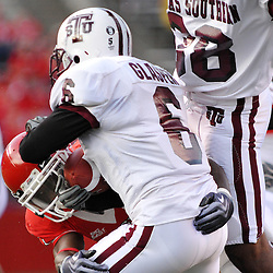 Oct 10, 2009; Piscataway, NJ, USA; Rutgers cornerback Devin Mccourty (21) tackles Texas Southern cornerback Darrell Glasper (6) on a kickoff return during second half NCAA college football action in Rutgers' 42-0 victory over Texas Southern at Rutgers Stadium.