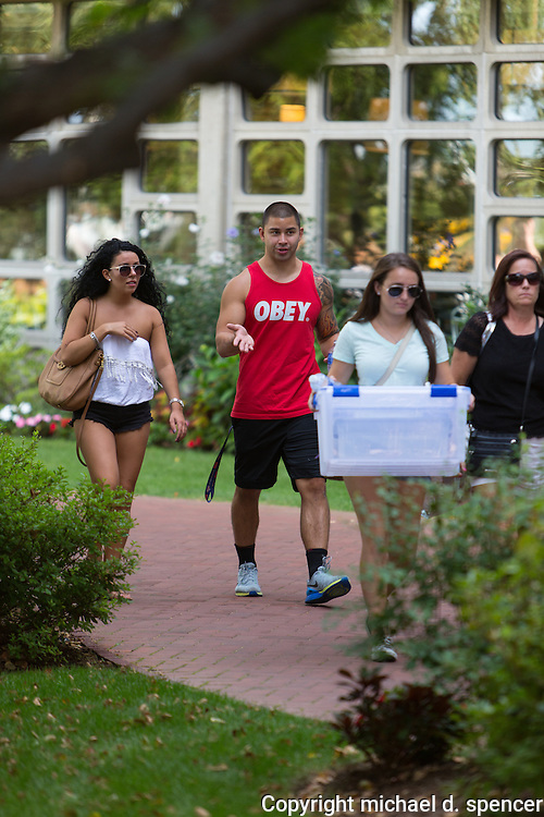 Cassie Finnegan CAS 2017, Dylan Chung SGT 2015 walking around West Campus at BU during move-in day
