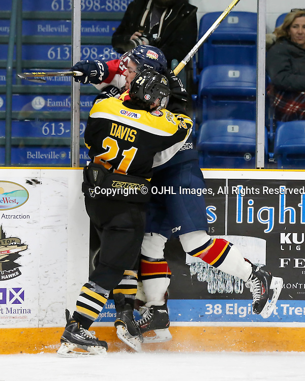 TRENTON, ON - JAN 24,  2017: Ontario Junior Hockey League action game between Aurora and Wellington at the 2017 Winter Showcase, Tyler Davis #21 of the Aurora Tigers makes the hit during the second period<br /> (Photo by Amy Deroche / OJHL Images)