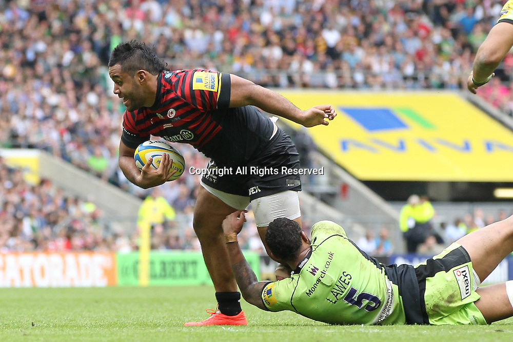 31.05.2014.  London, England.  Saracen's Billy Vunipola is tackled by Northampton's Courtney Lawes during the Aviva Premiership final match between Northampton Saints and Saracens at Twickenham Stadium.