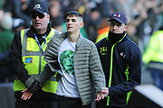 Disruptive Celtic fan is ejected during the Betfred Semi-Final Cup match between Heart of Midlothian and Celtic at Murrayfield, Edinburgh, Scotland on 28 October 2018.