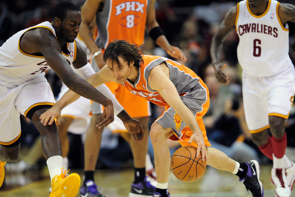 Jan. 19, 2011; Cleveland, OH, USA; Cleveland Cavaliers power forward J.J. Hickson (21) and Phoenix Suns point guard Steve Nash (13) fight for a loose ball during the second quarter at Quicken Loans Arena. Mandatory Credit: Jason Miller-US PRESSWIRE
