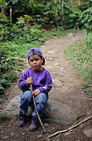 Boy, 3, sits on log to pout about hiking the Cheakamus trail near Whistler, BC, Canada
